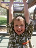 Child at play. Little boy on monkey bars Stock Photography