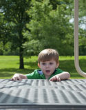 Child play. Kid play outdoors in the bright sun just having fun Stock Photography