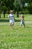 Child play. Young children in the park playing and having fun Royalty Free Stock Photos