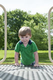 Child play. Young child having fun and playing in the park on a sunny day Stock Photos