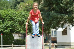 Child at play. Child playing on slide Royalty Free Stock Photos