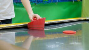 Children play in air hockey. Child play in air hockey stock footage