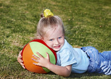 Child play with  ball in  park Stock Images