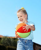 Child play with  ball in  park Stock Image
