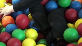 Child play in ball pit stock video