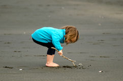 Child play on the beach. Little girl play on the beach Royalty Free Stock Image