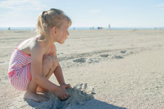 Child play beach. Little girl play sand sea beach summer holliday Stock Photos