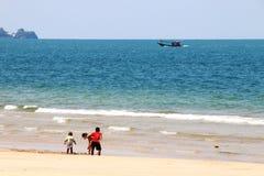 Child play on the beach Stock Photos