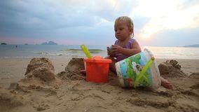 Child Play on the Beach at Sunset stock video footage