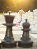 Child play chess figures outdoor Stock Photo