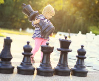 Child play chess figures outdoor Royalty Free Stock Photo