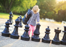 Child play chess figures outdoor Stock Image
