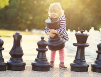 Child play chess figures outdoor Stock Images