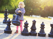 Child play chess figures outdoor royalty free stock photos