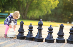Child play chess figures outdoor Royalty Free Stock Images
