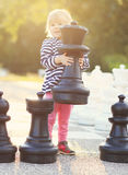 Child play chess figures outdoor Stock Photography
