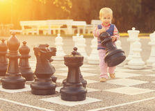 Child play chess figures outdoor Royalty Free Stock Photography