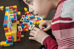 Child play with children's constructor toys Royalty Free Stock Photos