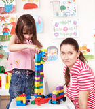 Child play construction with mother. Royalty Free Stock Photos
