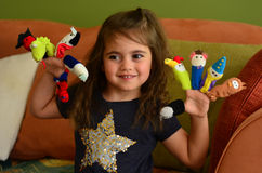 Child play with finger dolls. Child (girl age 04) play with finger dolls at home Royalty Free Stock Image