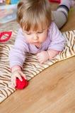 Child play on floor Stock Image