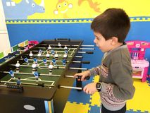 Child play foosball Royalty Free Stock Photo