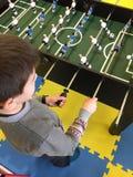 Child play foosball Royalty Free Stock Image