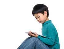 Child play game on tablet Stock Image