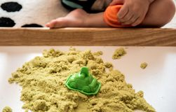 Child play with Kinetic sand stock photos