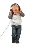 Child play with headphone Royalty Free Stock Photo