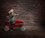 Child that play with his car waits for Santa Claus Stock Photos