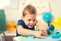 Child Play Modeling Plasticine. Royalty Free Stock Photos