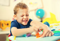 Child Play Modeling Plasticine. Royalty Free Stock Photography
