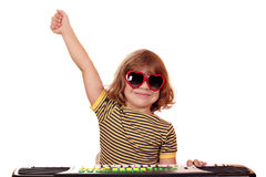 Child play music on keyboard Royalty Free Stock Photography
