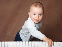 Child  play music on piano keyboard Royalty Free Stock Image