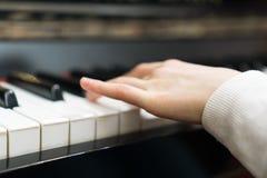 Child play the piano royalty free stock photos