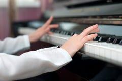 Child play the piano. Royalty Free Stock Photo