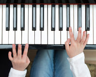 Child play the piano. Stock Photo
