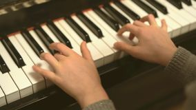 Child play the piano. stock video