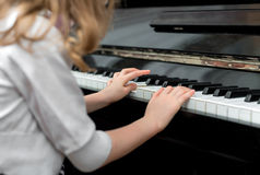 Child play the piano. Stock Image