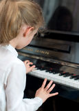 Child play the piano. Royalty Free Stock Photos