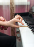 Child play the piano. royalty free stock image