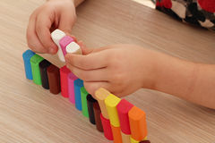 Child play with plasticine blocks Stock Photography