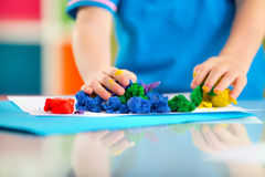 Child play with plasticine Stock Photography