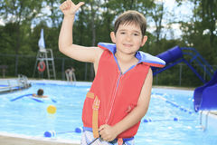 Child play at the pool place in a beautifull Stock Image