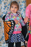 Child play pretend butterfly. Portrait of a child , little girl dress up in butterfly costume during Drama class. concept photo of child childhood, play pretend Royalty Free Stock Image
