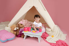 Child Play: Pretend  Food, Toys and Teepee Tent Royalty Free Stock Photography