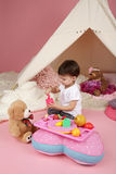Child Play: Pretend  Food, Toys and Teepee Tent Stock Images