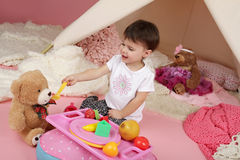 Child Play: Pretend  Food, Toys and Teepee Tent Royalty Free Stock Photo