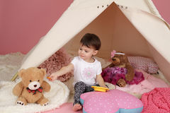 Child Play: Pretend  Food, Toys and Teepee Tent Stock Photography